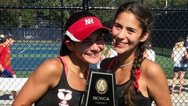 Northern Highlands' second doubles Camille Licini and Sarah Rimland showing their winning trophy from the Bergen County Tournament large schools championships over the weekend of Sept. 23-24, 2017.