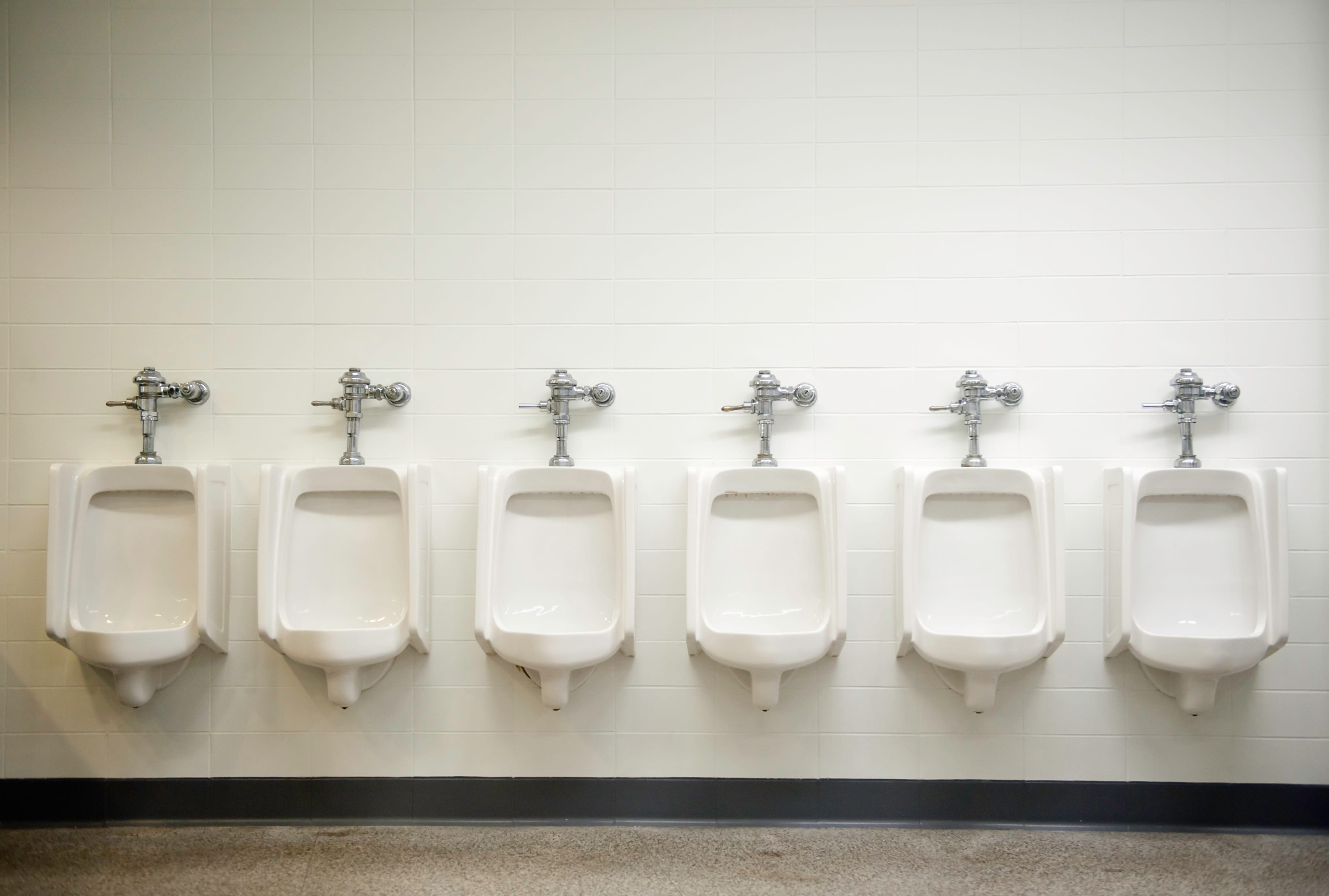 Attrayant Photograph Of A Row Of Six White Urinals