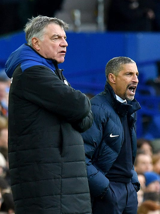 Brighton & Hove Albion manager Chris Hughton, right, and Everton manager Sam Allardyce react on the touchline during their English Premier League soccer match at Goodison Park in Liverpool, England, Saturday March 10, 2018. (Anthony Devlin/PA via AP)