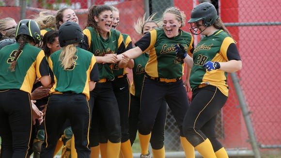 From right, Lakeland's Claire Fon (28) is greeted by teammates after hitting a grand slam home run against Eastchester during the Section 1 Class A championship at North Rockland High School  May 27, 2017. Lakeland won the game 15-5,