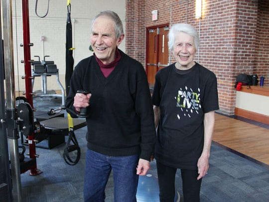 """Al and Donna Denman, right, work out in Antioch College's wellness center on March 10, 2017. Al, 89, and Donna, 83, are longtime supporters of Antioch and have been part of the community since Al, who's now retired, became a professor at Antioch in 1965, when the college was at its peak popularity. """"It was the most exciting place I'd ever been,"""" he said."""