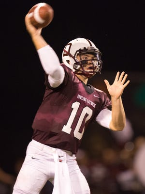 Dowling High School's Ryan Boyle (10) passes the ball on Lewis Central in the second quarter Friday, Sept. 26, 2014, at Valley Stadium in West Des Moines.