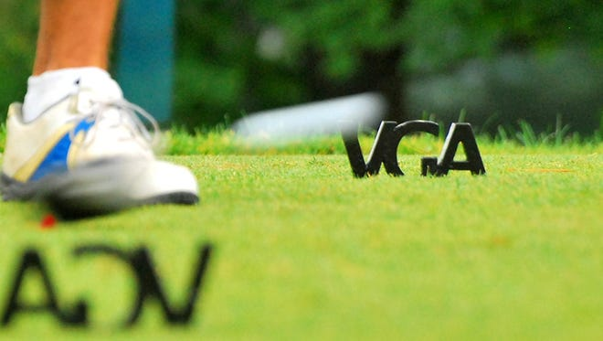 A player tees off the 11th hole during the 2011 Vermont Amateur at Neshobe Golf Club in Brandon.