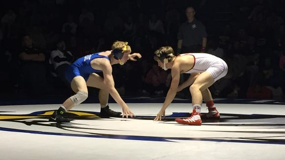 Eastside's Jordie White, left, squares off against Woodward Academy's Nick Masters in the 120-pound final of the Southern Slam at Eastside Saturday. Masters won by decision.