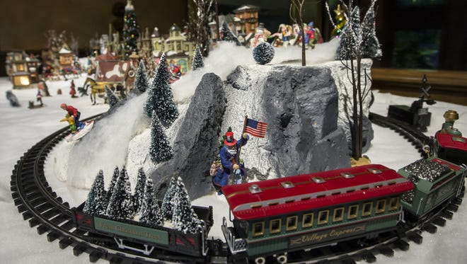 Miniature villages are on display as part of the Deck the Halls exhibit at the Oshkosh Public Museum in this file photo from 2014.