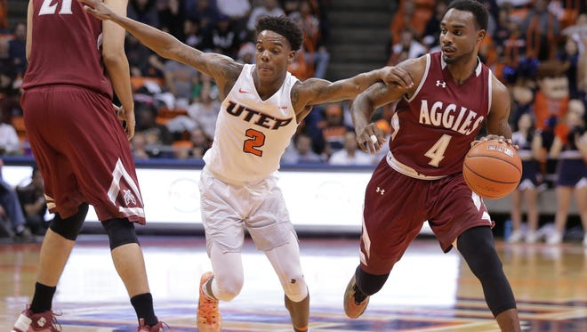 UTEP guard Omega Harris tries to slow down NMSU's Ian Baker after working through a screen by Tanveer Bhullar Tuesady at the Don Haskins Center.