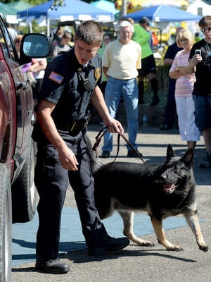 Centerville police officers Matthew Alexander and Kendra give a demonstration during Archway Days Saturday, Aug. 22, 2015 in Centerville.