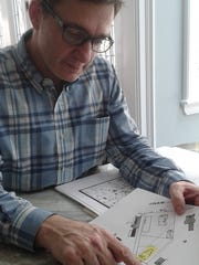Luis Barrio looks at an early map with a distinctive