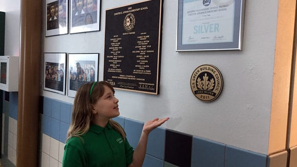Chester E. Jordan Elementary School fifth-grader Isabella Kelly shows off the school's LEED silver certification.