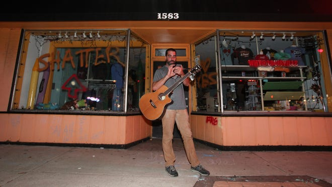 Will Russell stood outside of his store Why Louisville on Bardstown Rd. and checked social media.  He admitted to spray painting the facade.Sept. 9, 2015