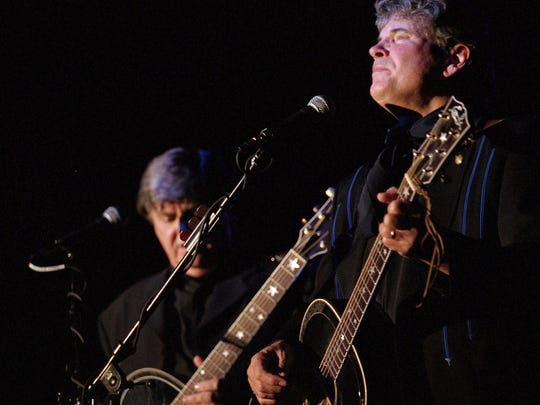 """Don Everly, right, and Phil Everly,  the duo that call themselves """"The Everly Brothers"""", perform at Camel Rock Casino in Pojoaque Pueblo, New Mexico, Sunday Oct. 15, 2000. They were rock 'n' roll pioneers, flooding the airwaves in the late '50s with their tight blend of percussive strumming and Appalachian harmonies.     Along with their contemporaries _ Chuck Berry, Jerry Lee Lewis, Little Richard, Elvis _ the Everly Brothers helped launch a new musical paradigm."""