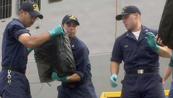 Six tons of narcotics, seized in August and September 2003, is off loaded in Mayport, Fla. Sept. 30, 2003 by Sailors assigned to the frigate USS Rentz.