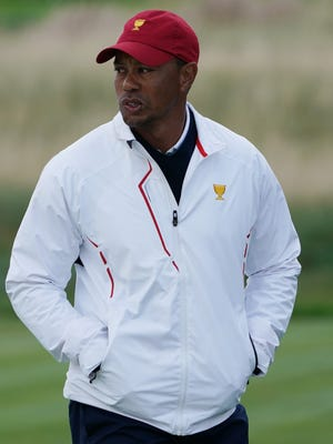 Tiger Woods, seen here during the Presidents' Cup on Sept. 30, has advanced to hitting a driver, according to his Twitter account.