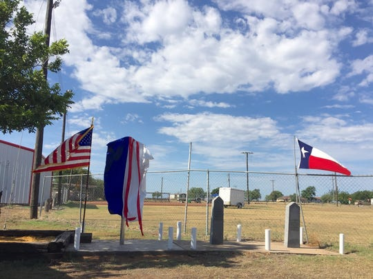 A historical marker waits to be unveiled in Rowena, Texas, during the community's official Texas Historical Marker dedication on July 1, 2017.