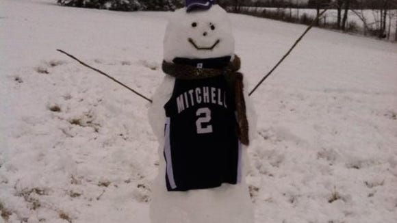 Mitchell boys basketball coach Daron Williams and his family built this snowman.