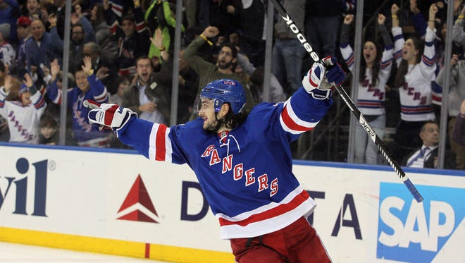 New York Rangers right wing Mats Zuccarello (36) reacts after scoring a goal against the Minnesota Wild during the second period of a game at Madison Square Garden.