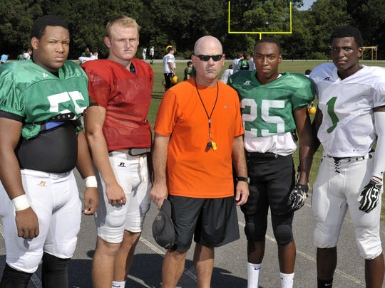 From left to right, Catholic High's Nelson Hale, Cody Henry, coach Greg Seibert, Emon Smith and Jeremy Reaves.