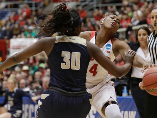 Ohio State's Sierra Calhoun, right, fouls George Washington's Neila Luma (30) in the first half during a first-round game in the NCAA women's college basketball tournament Saturday, March 17, 2018, in Columbus, Ohio. (AP Photo/Tony Dejak)