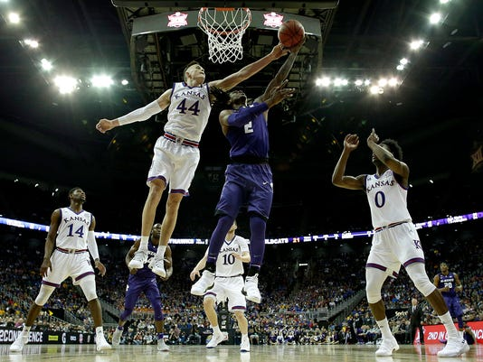 Kansas State's Cartier Diarra (2) shoots under pressure from Kansas' Mitch Lightfoot (44) during the first half of an NCAA college basketball game in the semifinals of the Big 12 conference tournament in Kansas City, Mo., Friday, March 9, 2018. (AP Photo/Charlie Riedel)