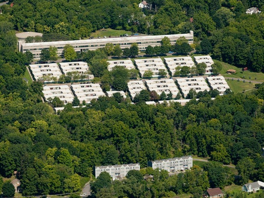 The West Village Apartment complex  consists of one long building at the top of the area and sections of one and two story apartments lower on the hill.