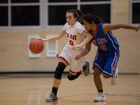 Ray's Alyssa Viera drives the ball up the court as