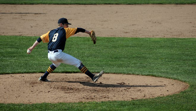 Huskies' Brett Manis tosses in a pitch Monday, May 2, during a varsity baseball match against Port Huron.