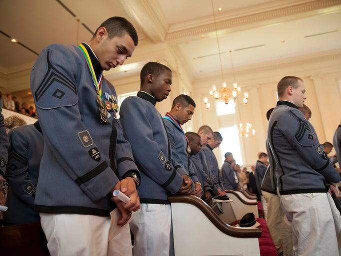 Seniors from Fishburne Military School bow their heads during the school's cadet prayer as part of their graduation ceremony at First Presbyterian Church in Waynesboro on Saturday, May 17, 2014.