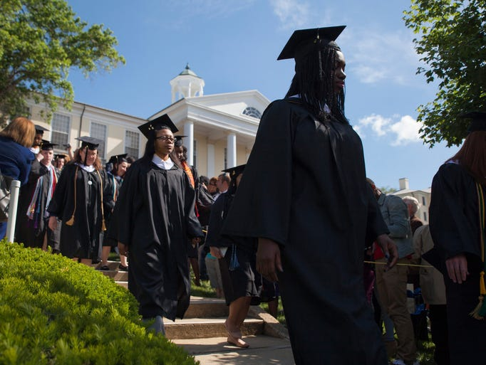 Mary Baldwin College students walk to Page Terrace during their graduation ceremony as part of the academic processional in Staunton on Sunday, May 18, 2014.