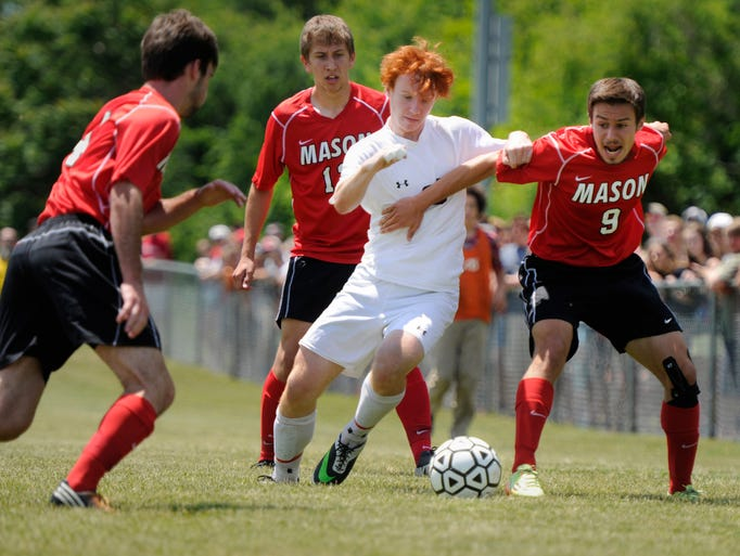 Riverheads' Ryan Kyler, left, battles for possession of the ball with George Mason's Sinan Kokuuslu during their 2A East Region finals game at Riverheads High School on Friday, June 6, 2014. Ultimately, Riverheads effort was not enough to take down George Mason, and they lost 2-3.