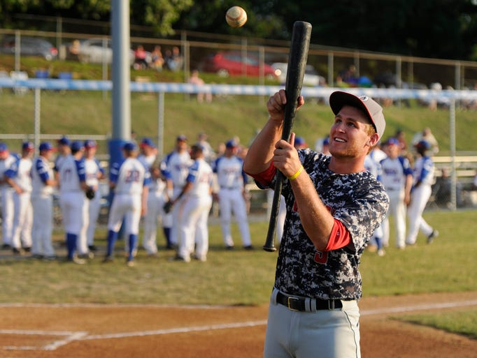 The Waynesboro Generals' Jordan Harmon warms up with a bunting drill before the team's game against the Staunton Braves on Tuesday, June 17, 2014.