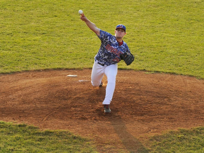 The Staunton Braves' Ryan Meisinger pitches to a Winchester Royals player during their game in Staunton on Wednesday, June 18, 2014.