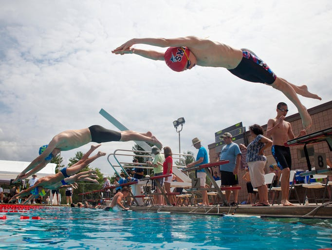 SMAC's Tate Snyder dives into the water to start the boys' 200 meter freestyle during the Commonwealth Games of Virginia at War Memorial Pool in Waynesboro on Saturday, June 28, 2014.