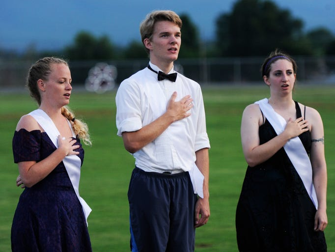 Players sing the National Anthem during Soccer Prom, which benefits the Boys & Girls Club of Waynesboro, Staunton, & Augusta County, held at Stuarts Draft High School on Saturday, June 28, 2014.