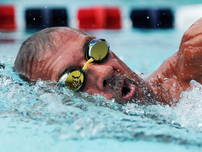 SMAC's Greg Harris comes up for a breath while competing in the boys' 1500 meter freestyle during the Commonwealth Games of Virginia at War Memorial Pool in Waynesboro on Sunday, June 29, 2014.