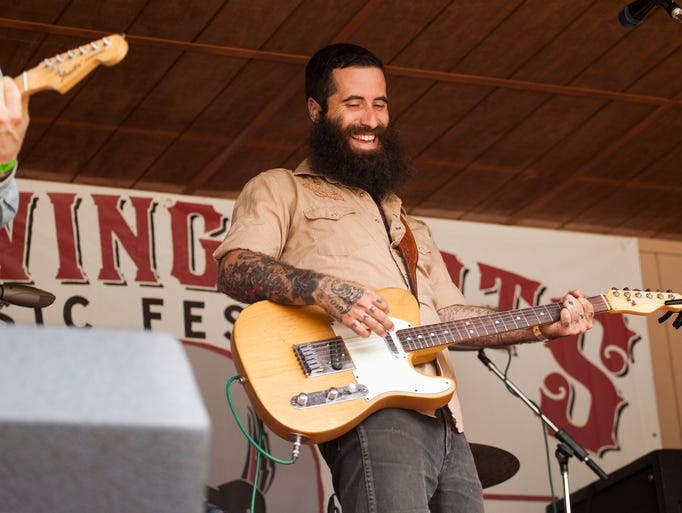 J.P. Harris, of J.P. Harris & The Tough Choices, laughs on stage during the band's performance at the Red Wing Roots Music Festival in Mount Solon on Sunday, July 13, 2014.
