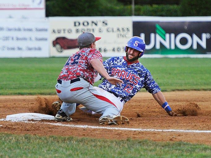 The Staunton Braves' Hunter Thomas slides under the tag of Waynesboro Generals third baseman Tyler Orris during their game in Staunton on Wednesday, July 16, 2014.