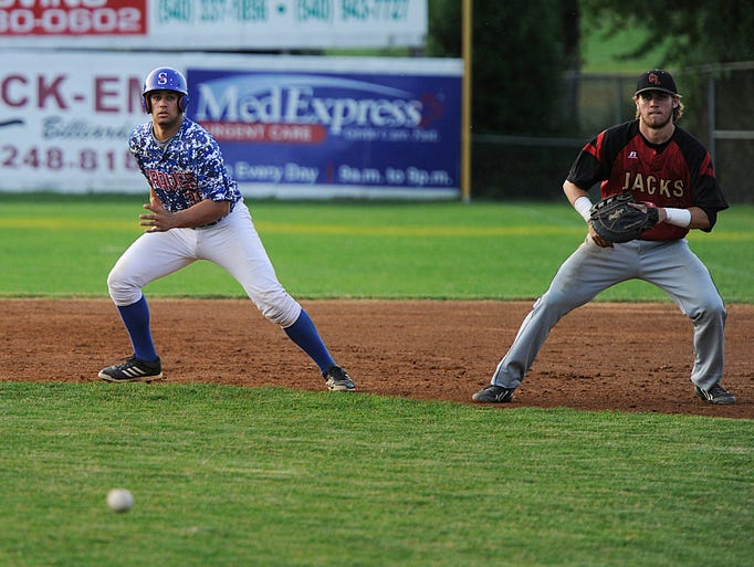 The Staunton Braves' Juan Escarra takes off toward second base after a hit against the Covington Lumberjacks during their game in Staunton on Tuesday, July 22, 2014.