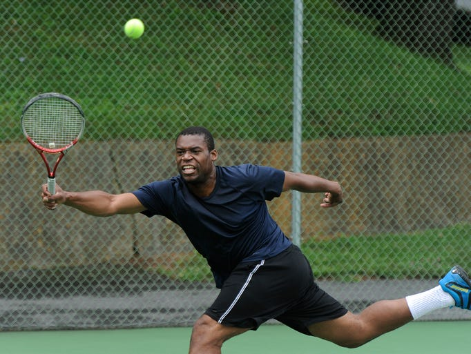 Mike Mungin returns the ball during an open men's singles match in the Augusta Health/News Leader Tennis Tournament at Mary Baldwin College on Sunday, July 27, 2014.