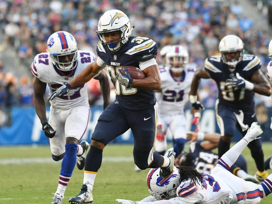 Nov 19, 2017; Carson, CA, USA; Los Angeles Chargers running back Austin Ekeler (30) runs for a touchdown against the Buffalo Bills in the second half of a NFL game at StubHub Center. Mandatory Credit: Richard Mackson-USA TODAY Sports