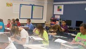 Sabine parish school students at work in a classroom.