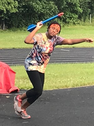 Alisha Hill, 12, practices throwing the turbo javelin at Mehock Field. It's one of three events she will compete in for the Blessed To Run summer track club at the AAU Junior Olympics.