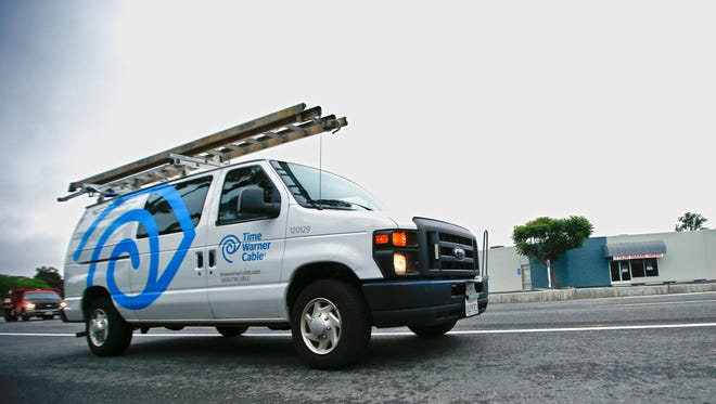In this May 27, 2015 photo shows a Time Warner Cable service truck in Carlsbad, Calif.