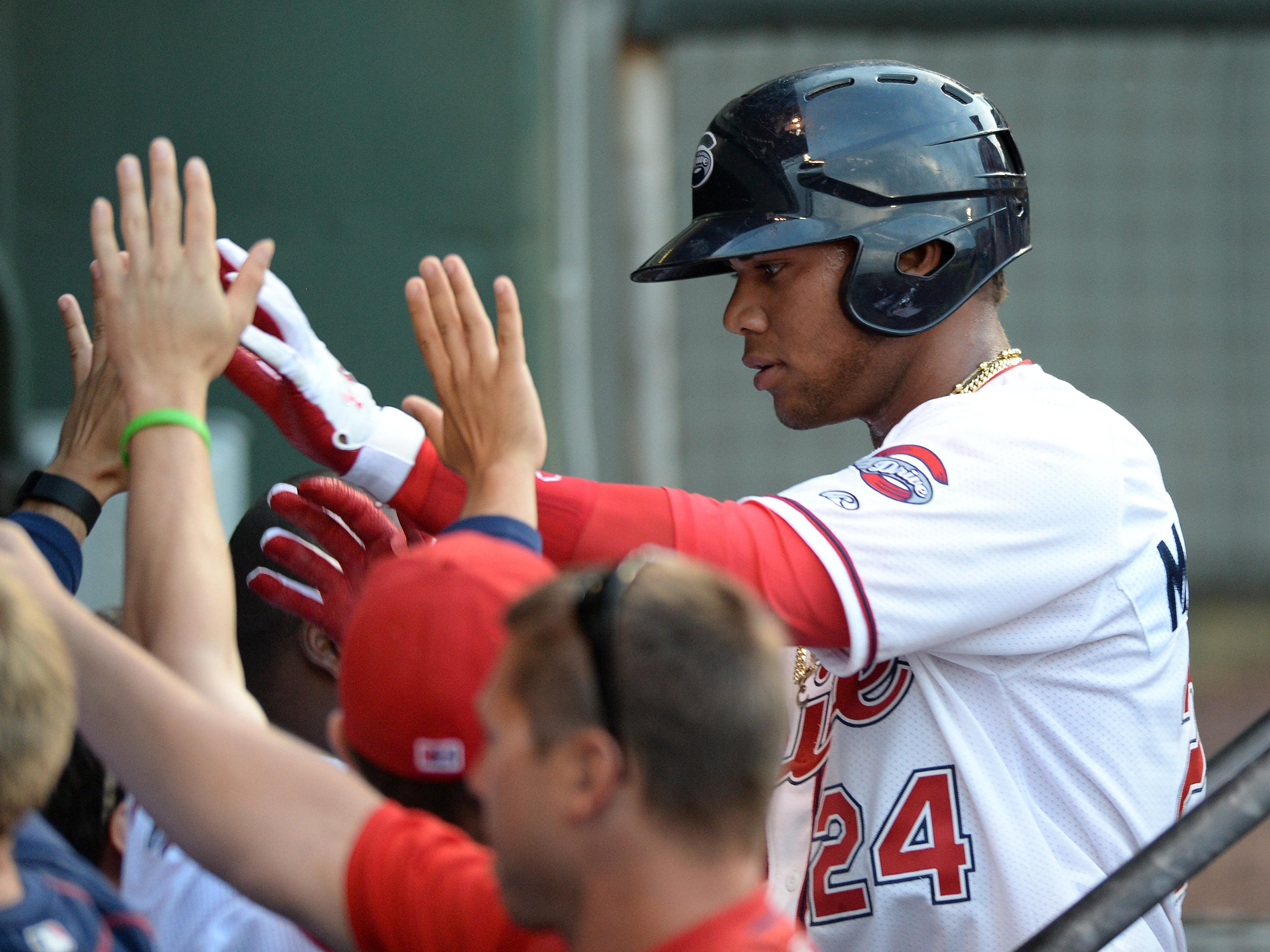 Yoan Moncada (24) hit a leadoff home run Wednesday to start the Greenville Drive's 7-0 win against Greensboro.