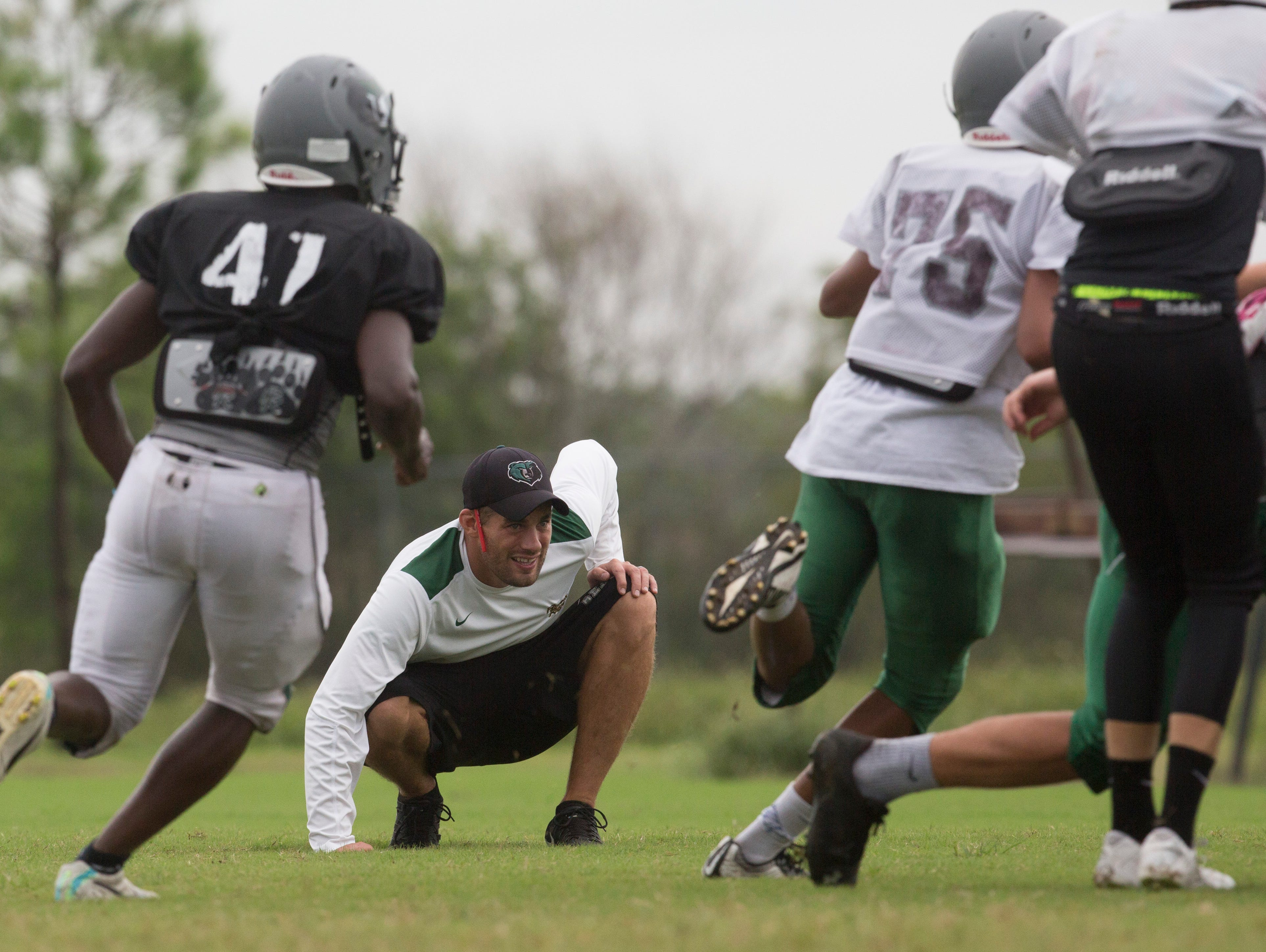 Palmetto Ridge High School first-year football coach Chris Toukonen coaches his players during a Tuesday afternoon practice. The Bears are 4-0 this year.