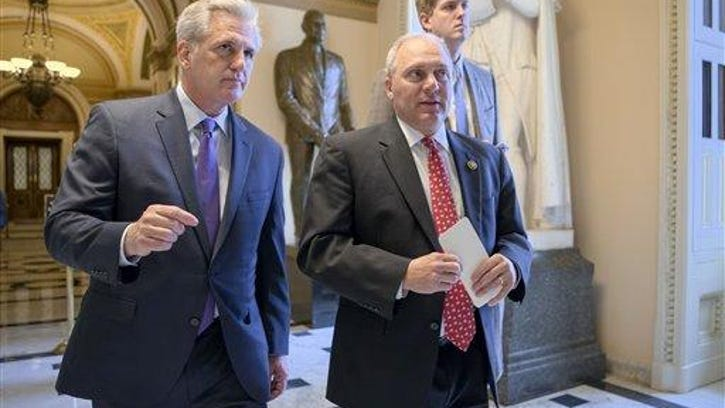 House Majority Leader Kevin McCarthy of Calif., left, and House Majority Whip Steve Scalise of La., stride from the House chamber on Capitol Hill in Washington, Wednesday, Nov. 18, 2015, as House Republicans work on legislation aimed at increasing screenings for Syrian and Iraqi refugees before they enter the U.S., including a new requirement for FBI background checks.