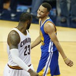Cleveland Cavaliers forward LeBron James (23) and Golden State Warriors guard Stephen Curry (30) have the season come down to one game for the NBA title.