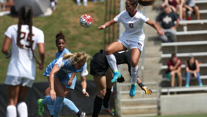 FSU's Deyna Castellanos leaps to knee the ball against UNC during their match at the Seminole Soccer Complex on Sunday.