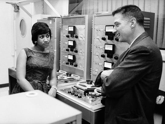 "Aretha Franklin, pictured in the book ""Respect: The Life of Aretha Franklin"" by David Ritz with producer John Hammond, who discovered the singer when she was 18."