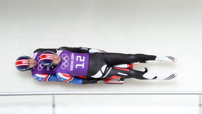 Christian Niccum and Jayson Terdiman of the USA prepare for Wednesday's luge competition.