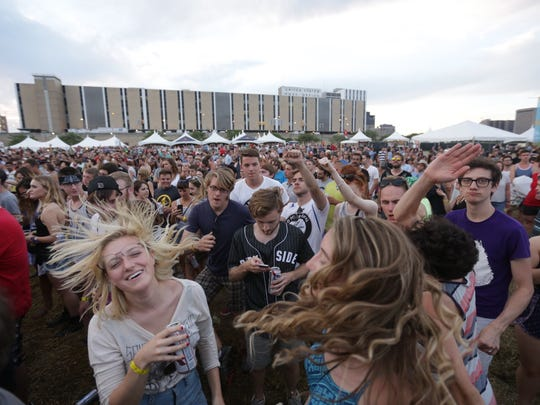 The crowd dances to Jessica Hernandez as she performs during the Mo Pop Festival at the West Riverfront Park in Detroit on Sunday July 25, 2015.
